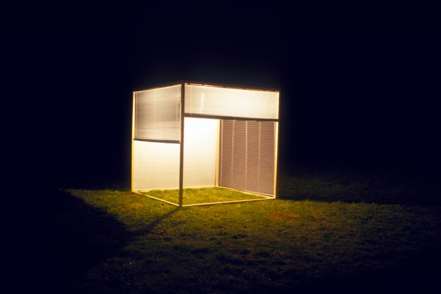 Francisco Ugarte, Sin título (Caja de Persianas), 2002. Wood, window blinds, and lights, 2.44 x 2.44 x 2.44 m. Courtesy the artist.
