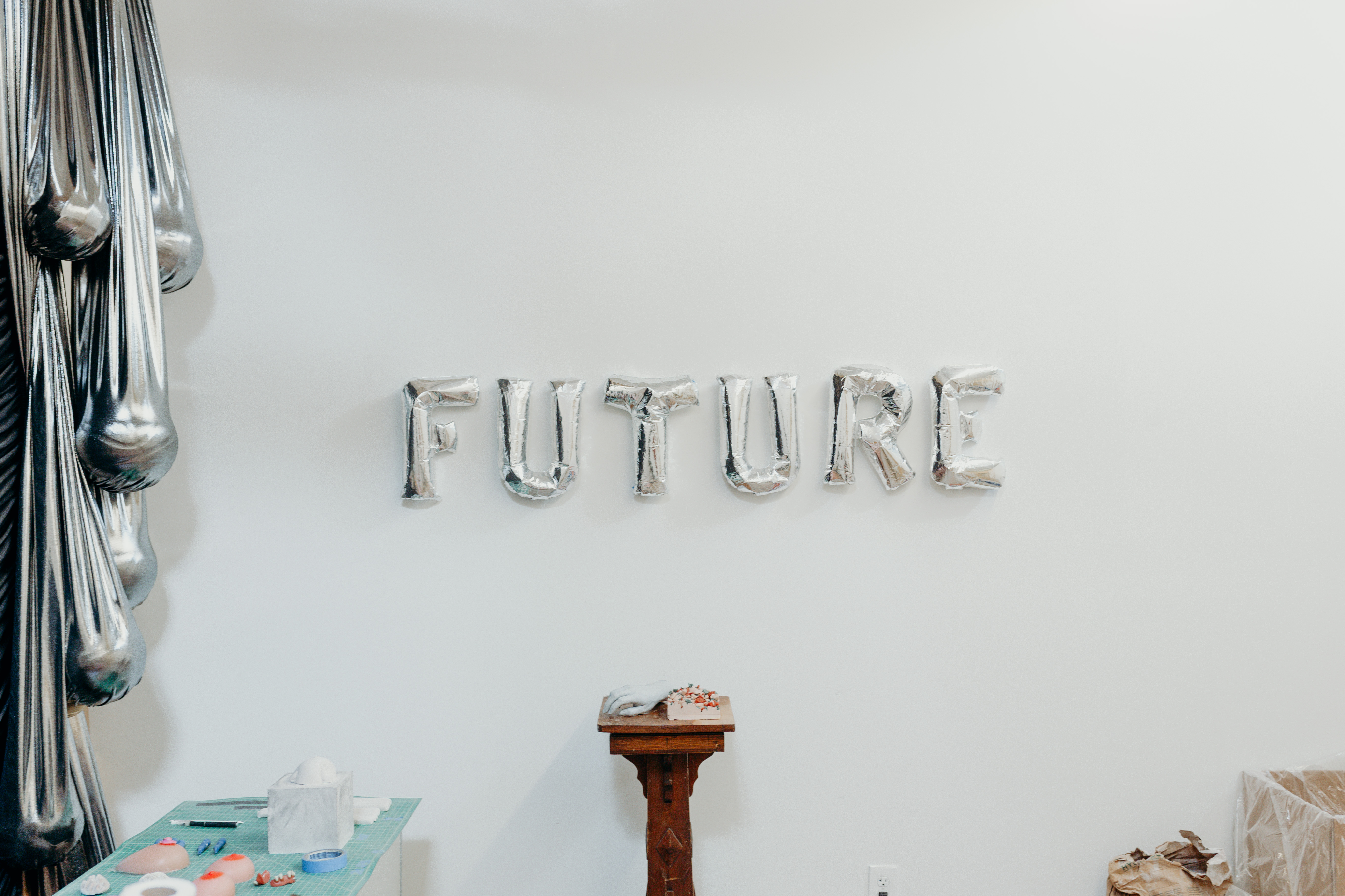 The word FUTURE is spelled out on the wall from balloons.