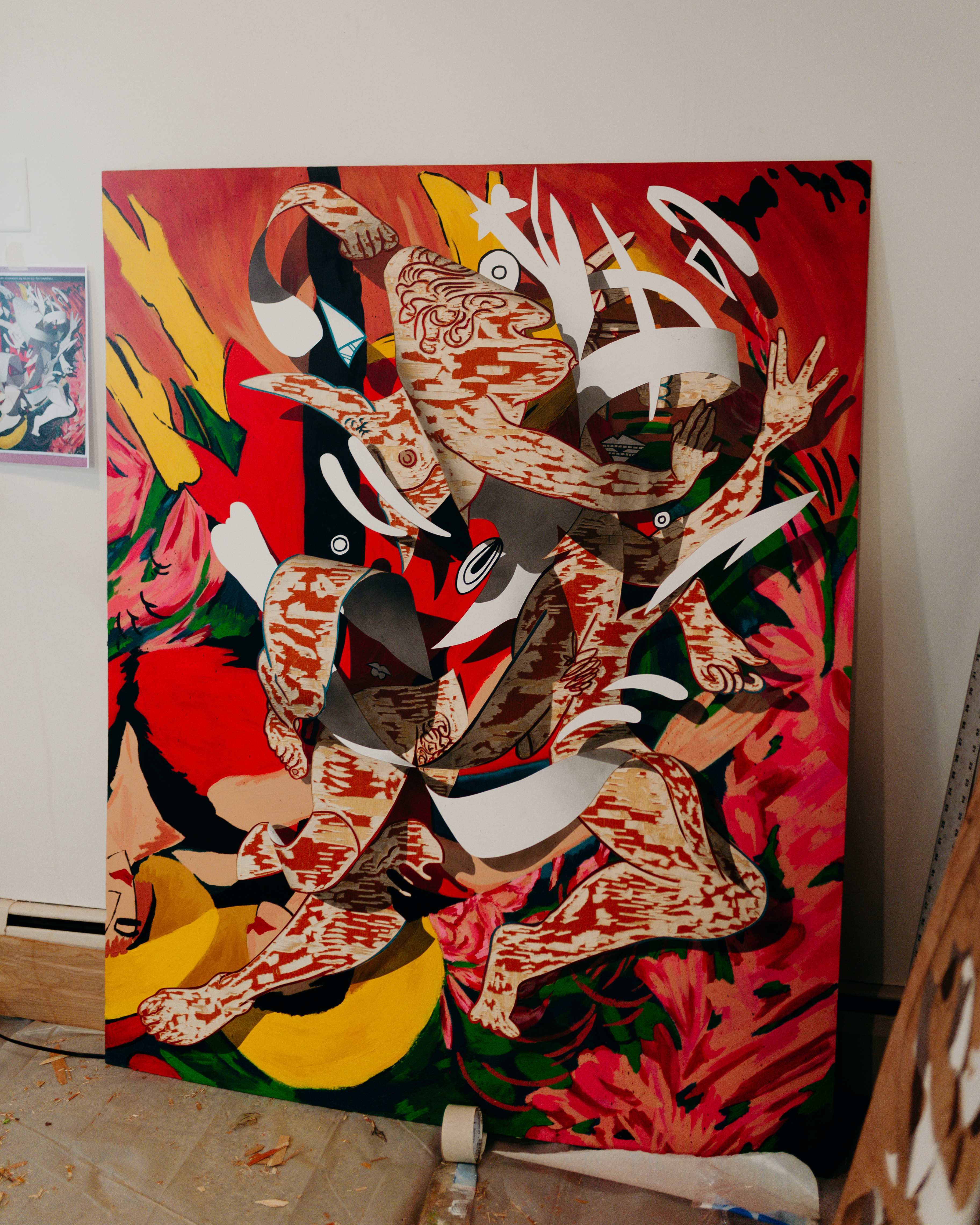 A large painting creates the illusian of paper swirling above the surface of the canvas.
