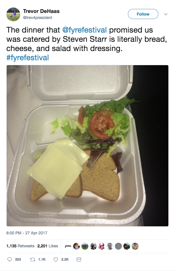 Screenshot of a tweet by Trevor DeHaas reading The Dinner that fyre festival promised us catered by Steven Starr is literally bread, cheese, and salad with dressing. An image of bread, cheese, and salad with dressing in a styrofoam container.