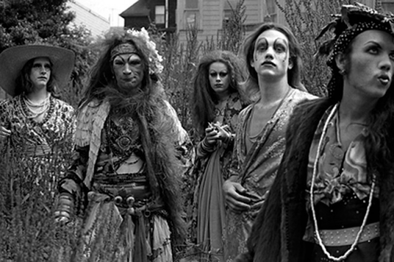Black and white image of five people in theatrical makeup at an outdoor space.