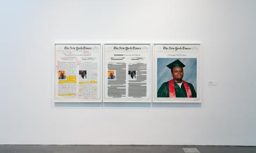 [Image description: An installation image of a work by Alexandra Bell hung on a white wall in one of the MCA Denver galleries. The work is a framed triptych with annotations of front-page layouts of the headlines in the NYT that report on the murder of Michael Brown.]