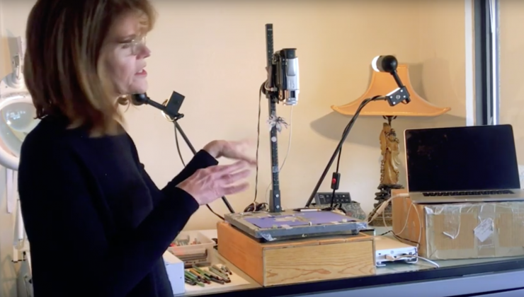 Screenshot of Stacey Steers in her studio space. It consists of a laptop and stop motion recording hardware.